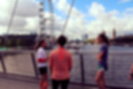 Running guide explaining the sights to runners with iconic London sights in the background