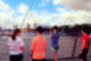 Joggers taking in the views across the Thames on Iconic London 10k run