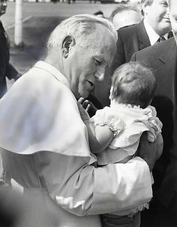 Pope John Paul II with a child.jpg