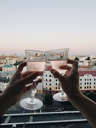 Canva - Two Persons Tossing Clear Wine G