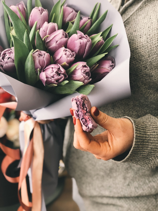 Canva - Person Holding Pink Tulip Bouque