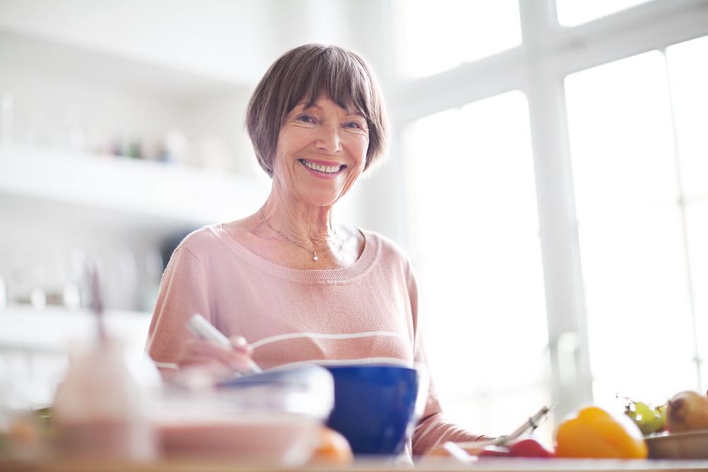 lady cooking inher kitchen