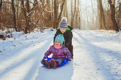 young kids sledding
