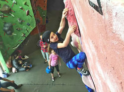 Monkeying around on bouldering wall