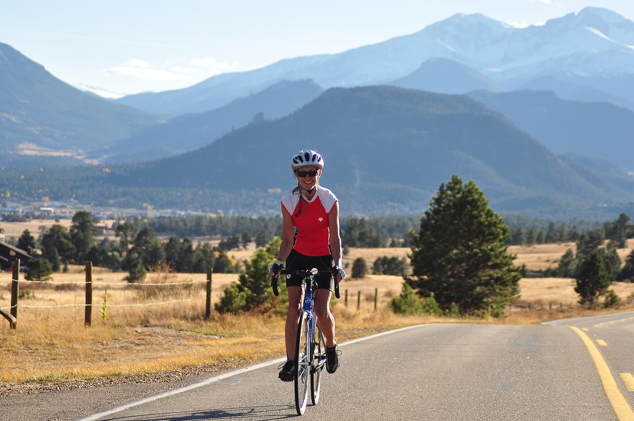 female road biker on mountain road