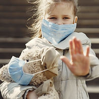 serious-girl-in-protective-mask-holding-