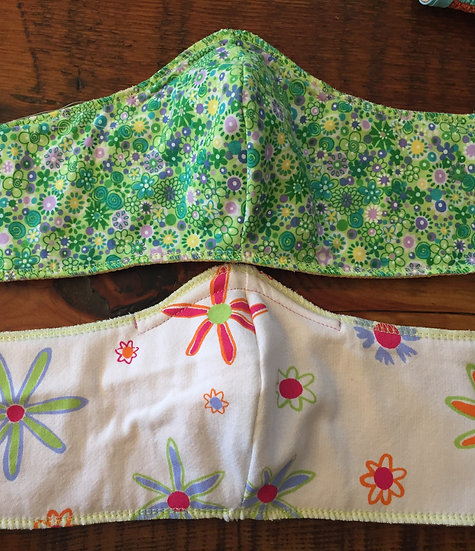 White backround with flowers, green and purple flowers on back. Reversible.