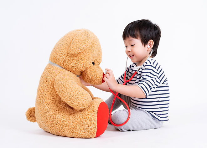 little-boy-playing-doctor-with-teddy-bea