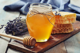 Honey in jar with honey dipper on vintag