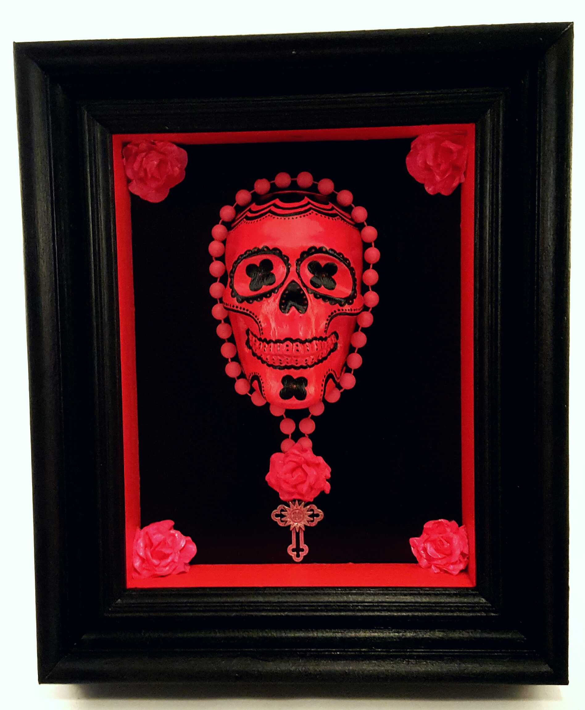 Fluorescent pink sugar skull with metal medallion_