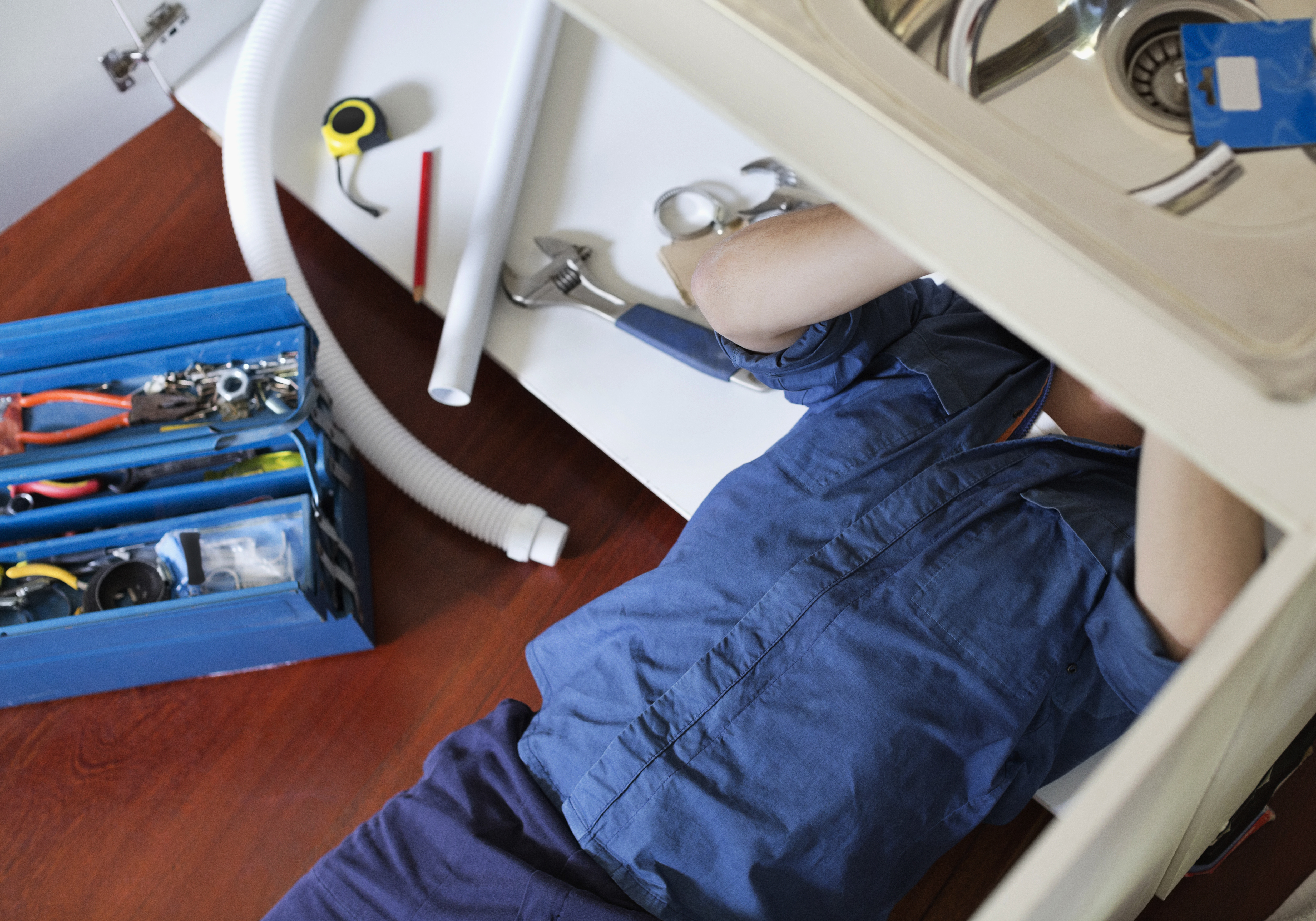 Plumber Fixing Sink | AF Plumbing and Drain