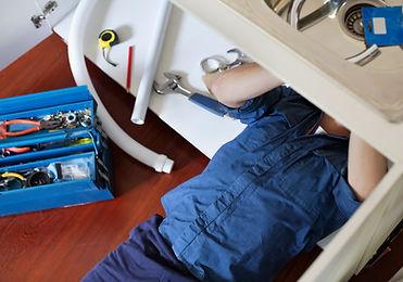 UHS Plumber Fixing Sink