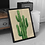 Large framed image of a Cactus Plant propped up against a small cabinet