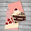 A small pile of mini print postcards featuring a slice of Black Forest gateau and a slice of raspberry pavlova