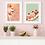 A framed knickerbocker glory wall print hanging beside a banana split art print in a kitchen setting