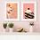 A framed knickerbocker glory wall print hanging beside a Black Forest gateau art print in a kitchen setting