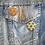 2 geometric patterned button badges on a denim jacket