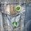 2 retro house plant button pin badges on a denim jacket