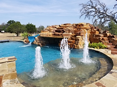 pool with rock design and fountain.jpeg