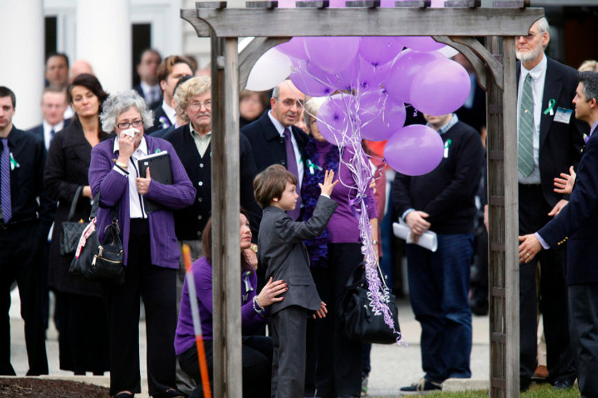 Jake Hockley releasing balloons at Dylan's memorial service