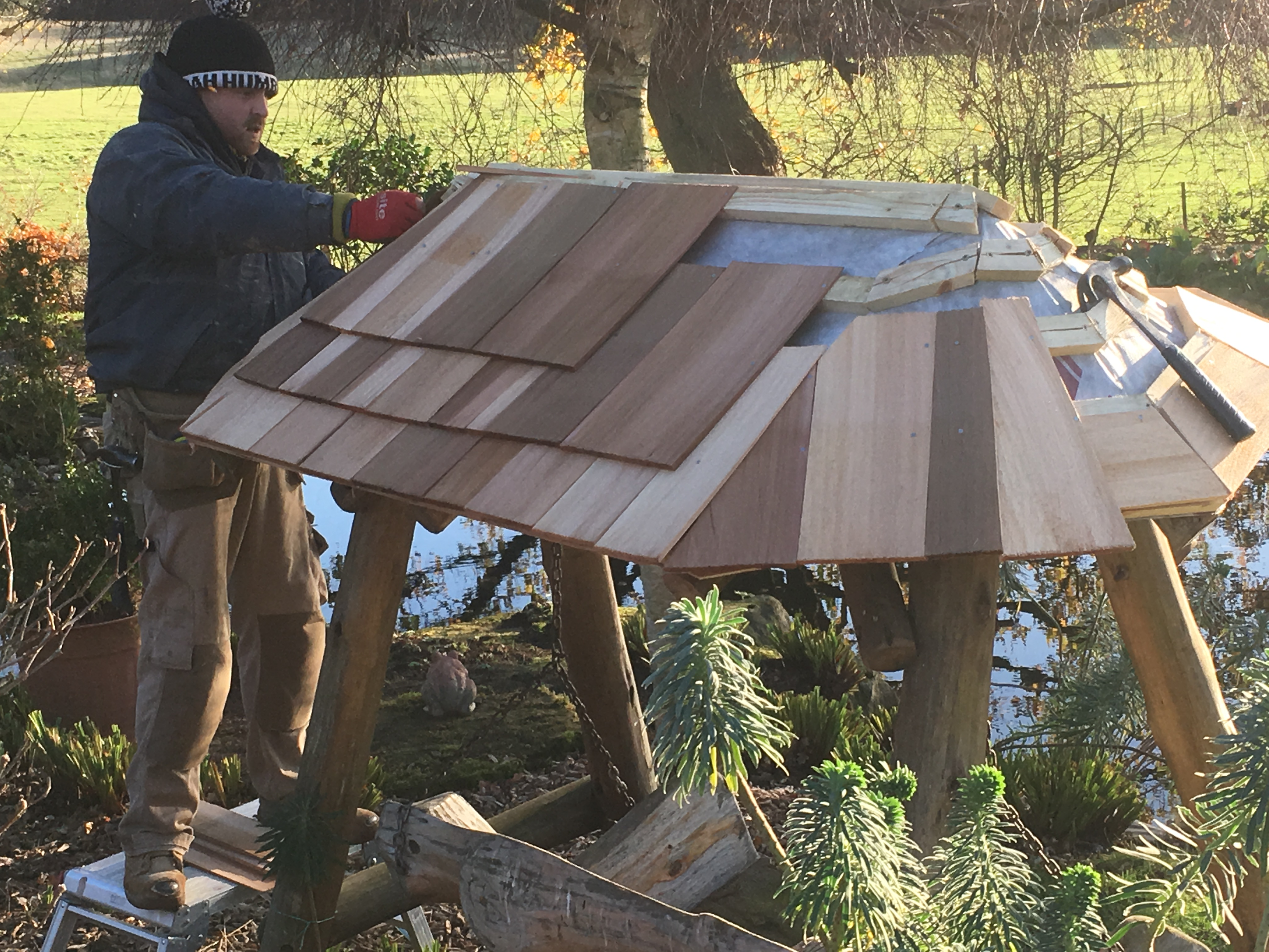 New cedar shingles on bench and pergola roof