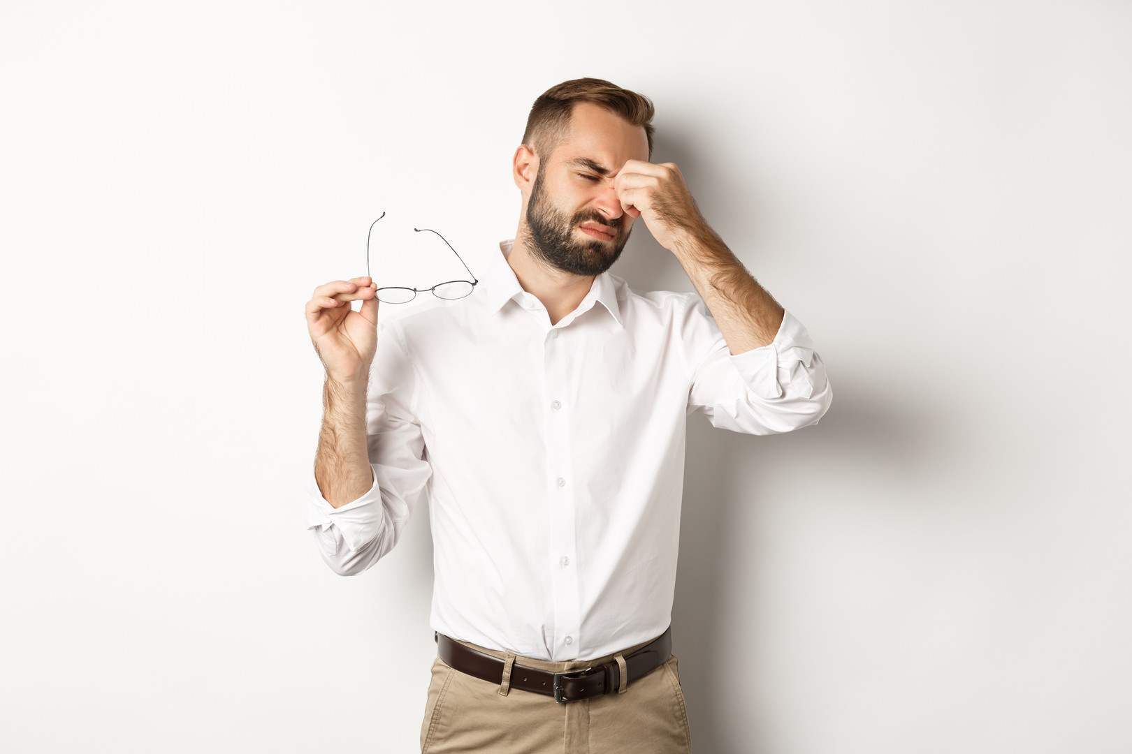 tired-businessman-take-off-glasses-rubbi