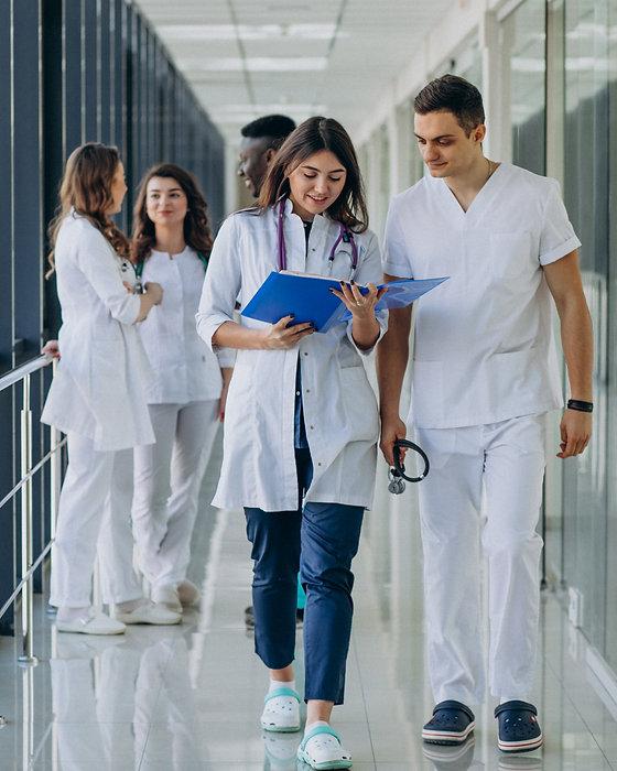 team-young-specialist-doctors-standing-c