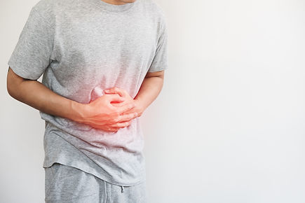 man-pressing-his-stomach-with-red-highli