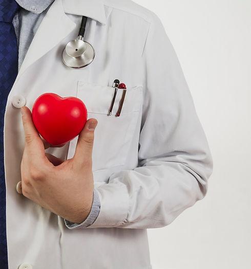 doctor-presenting-plastic-heart_edited.j