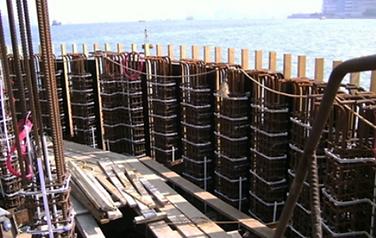 Installation of Titanium Ribbon on Rebar at Pier