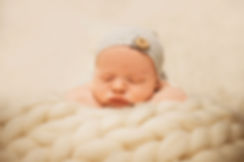Newborn baby posing on his arms
