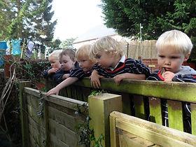 Bingham children looking over fence