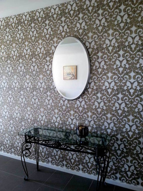 Gold Baroque curvy style wall paper, with Oval mirror and hall table