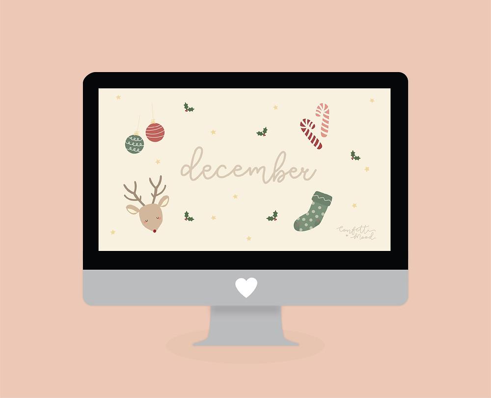 immagine di un computer con gli sfondi di natale con una renna i bastoncini di zucchero una calzetta e due palline.
