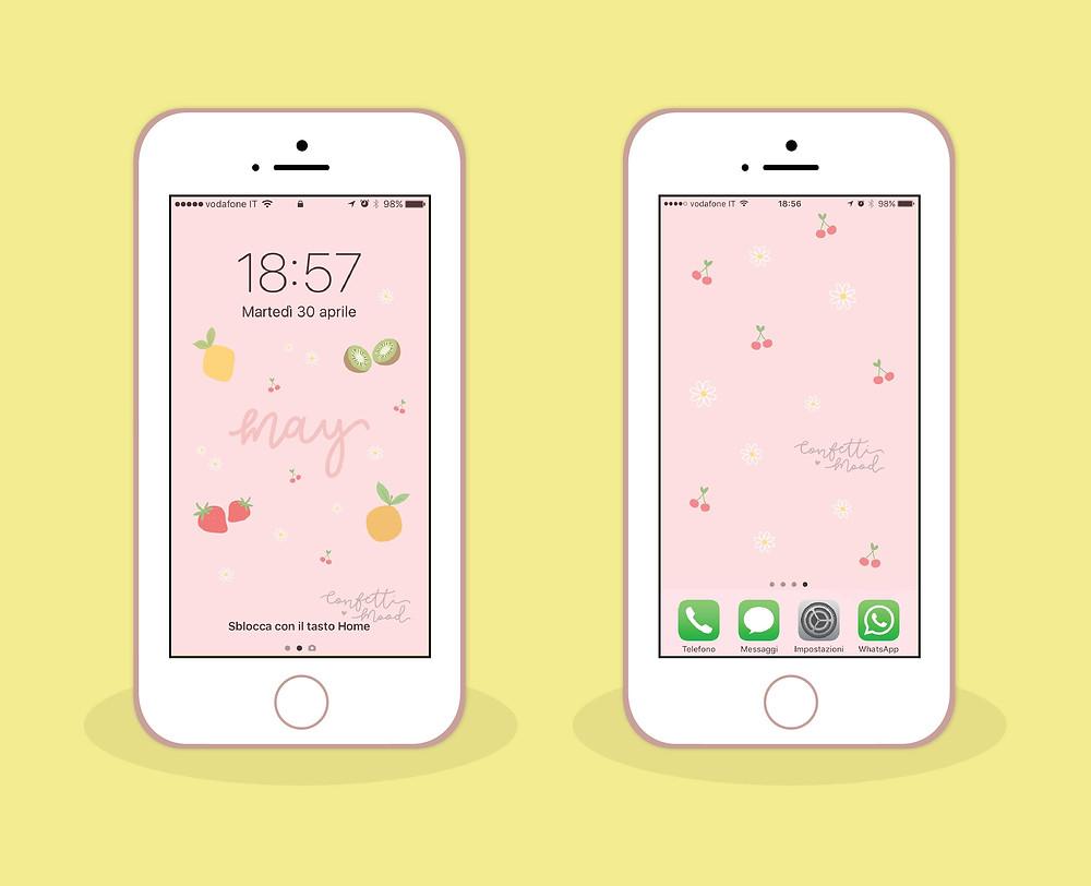Immagine degli sfondi per cellulari di Maggio. L'illustrazione rappresenta due cellulari. Il primo ha come screensaver lo sfondo per schermata home che riprende lo sfondo per computer. Il secondo ha uno sfondo un pattern di ciliege e margherite.