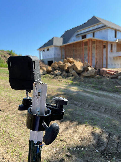 Afidus camera mounted on garden stake on live construction site.