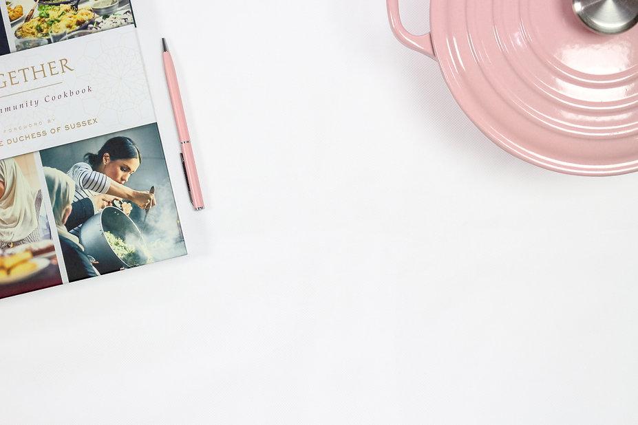 pink-click-pen-near-cooking-pot-1464880_
