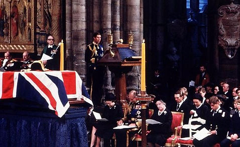 Prince Charles, The Prince of Wales reading the lesson at Mountbatten's ceremonial funeral  in Westminster Abbey,  Queen Elizabeth II and members of the Royal Family are seated to the left of the catafalque with Mountbatten's coffin