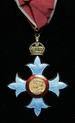 The insignia of a Commander of the Most Excellent Order of the British Empire (CBE)