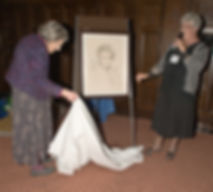 Patricia unveiling Corbet's portrait of herself 