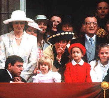 The Knatchbull family join members of the Royal Family on the balcony of Buckingham Palace for Trooping the Colour in 1991. Leonora Knatchbull (in red) is standing next to  Diana, Princess of Wales