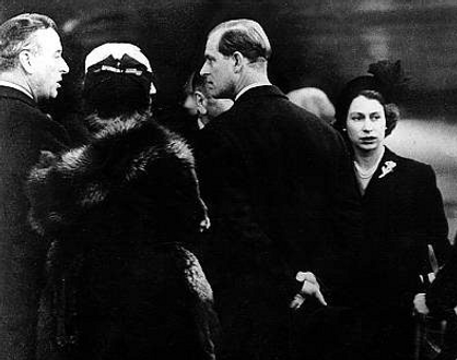 The arrival of Queen Elizabeth II & Prince Philip, The Duke of Edinburgh at Heathrow Airport, London - having returned home from Kenya following the death of King George VI.  Mountbatten (left) was in the official welcoming party 