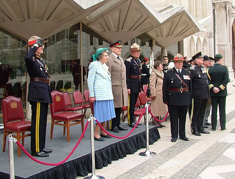 Patricia taking the salute at the Legion of Frontiersmen's Centenary Parade outside the City of London's Guildhall 