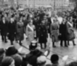 The funeral procession of Philip's sister - Princess Cecilie, and members of her family in Darmstadt, 1937. Philip is second from the right in the front row of mourners  ​
