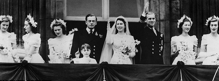 The balcony of Buckingham Palace after the wedding of Princess Elizabeth (now Queen Elizabeth II) to Prince Philip, The Duke of Edinburgh in November 1947.  The best man (on the left of the Princess) is David, 3rd Marquess of Milford Haven and the bridesmaid far right is Mountbatten's youngest daughter Pamela (later Lady Pamela Hicks) 