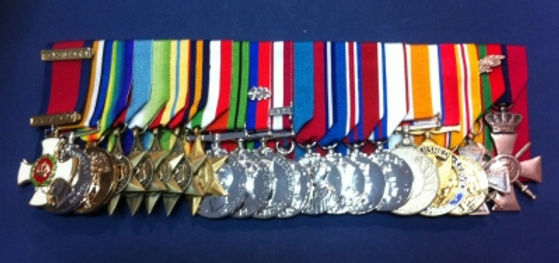 THE DISTINGUISHED SERVICE ORDER (DSO) & MOUNTBATTEN'S CAMPAIGN, COMMEMORATIVE & SERVICE MEDALS etc -  including - The British War Medal (WWI), The Victory Medal (WWI), The 1939-1945 Star (WWII), The Atlantic Star (WWII), The Africa Star (WWII), The Burma Star (WWII), The Italy Star (WWII), The Defence Medal (WWII), The War Medal 1939-1945 (WWII),  The Naval General Service Medal, The King George V Coronation Medal, The King George V Silver Jubilee Medal,  The King George VI Coronation Medal, The Queen Elizabeth II Coronation Medal, The Queen Elizabeth II Silver Jubilee Medal, The Indian Independence Medal, The Distinguished Service Medal (USA), The Asiatic-Pacific Campaign Medal (USA), Croix de Geurre 1939-1945 (France)