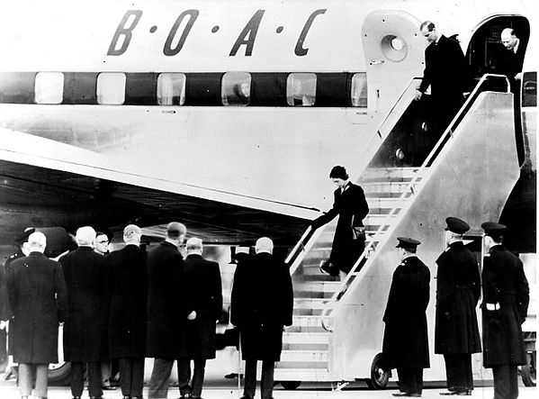 Queen Elizabeth II followed by Philip coming down the steps of BOAC Atalanta at Heathrow Airport, London on arrival back in the UK following the death of King George VI ​