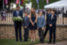 The Hon. Timothy Knatchbull (with the wreath) with his wife and children at the statue of Mountbatten, off Horse Guards Parade 