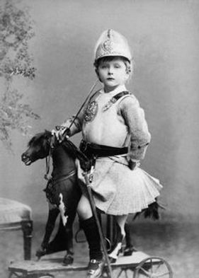 Leopold as a child, dressed in a soldier's uniform ​