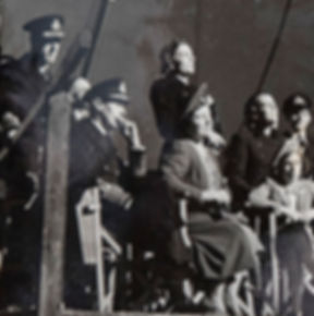 "The visit of King George VI, Queen Elizabeth & Princess Margaret (seated) to the set of ""In Which We Serve"" at Denham Film Studios. Mountbatten & Edwina can be seen standing behind The King & Queen"